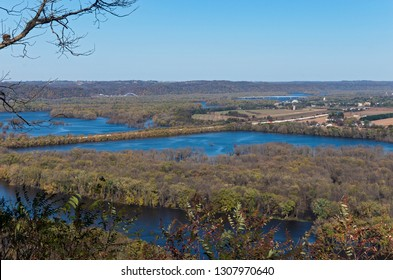confluence of wisconsin and mississippi rivers from atop bluffs at wyalusing state park and iowa in distance