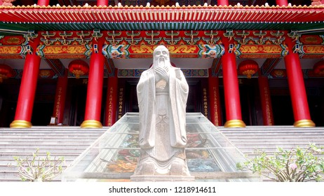 confucius statue with chinese historic traditional architecture background
