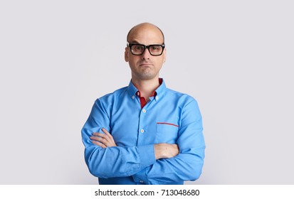 confused bald man wearing glasses isolated on white. Guy raised eyebrow