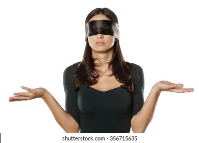 confused blindfolded woman on a white background
