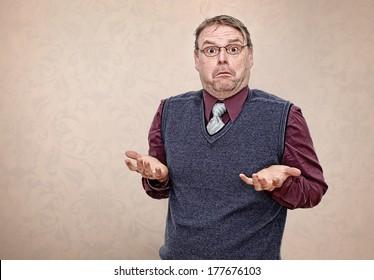 Confused Business Man Shrugging his Shoulders
