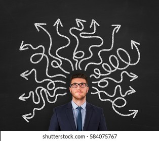 Confused businessman - people feeling confusion and chaos. Indecisive, disorientated and bewildered man stressed with headache over decision making