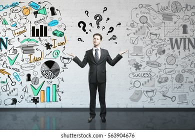 Confused businessman with questions in brick interior with business drawings