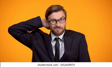 Confused businessman scratching head, hopeless situation, lack of knowledge