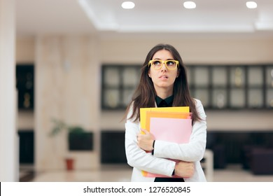 Confused Businesswoman Holding Paperwork in Office Building. Funny nervous employee waiting for job interview