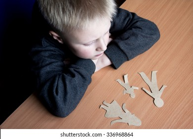 Confused child with broken paper family, family problems, divorce, custody battle, suffer concept