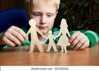 Confused child with paper family, custody, family problems, divorce, suffer concept