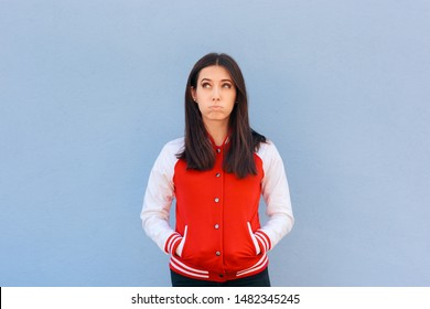 Confused Clueless Woman Wearing  College Style Jacket.Portrait of a puzzled female student having questions to ask