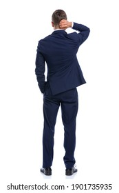 confused elegant guy in navy blue suit holding hand in pocket, scratching head and thinking, standing isolated on white background in studio