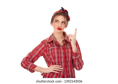 Confused girl. Latin American woman thinking in looking pensive and skeptical in casual clothes red checkered shirt looking to the side up isolated on white background