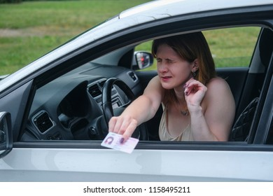 confused girl offers police officer a driver's license