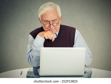 Confused grandfather using a pc