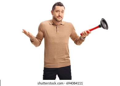 Confused guy holding a plunger and looking at the camera isolated on white background