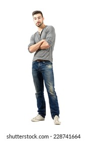 Confused man with crossed arms. Full body length isolated over white background.