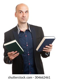confused man holding two books in hands, deciding which one to choose. isolated