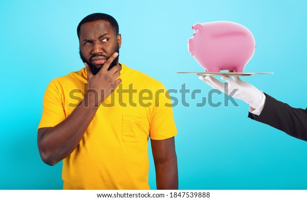 Confused man is suspicious about a guaranteed savings. concept of options, confusion, indecision
