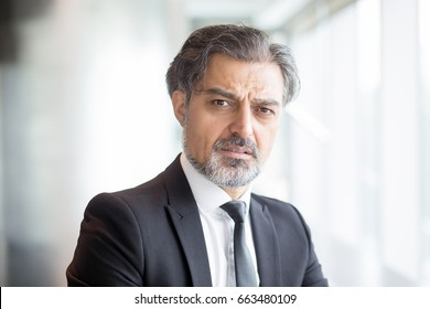 Confused senior businessman wearing suit