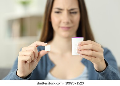 Confused woman dobting between sugar and saccharine at home