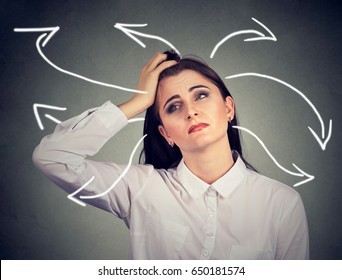 Confused woman with many twisted arrows coming out of her head