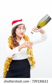 Confused woman pouring wine from empty bottle