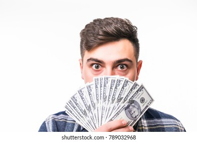 Confused young businessman covered his face with money over white