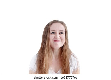 Confused young caucasian woman with disgusted facial expression and grimacing, isolated on white background. Negative emotion.