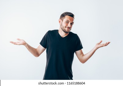 Confused young man have a doubt gesturing with hands