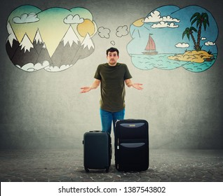 Confused young man traveler standing behind his luggage don't know where to go. Perplexed tourist guy has problems to choose vacation destination between sea and mountains trip. Split thinking.