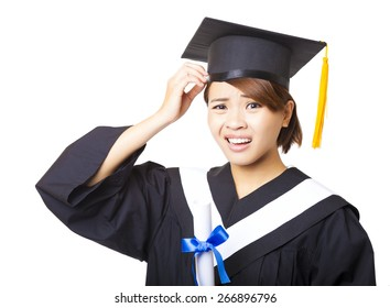 confused young woman graduating holding diploma and looking