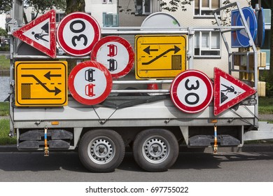 Confusing traffic signs on a trailer in the Netherlands