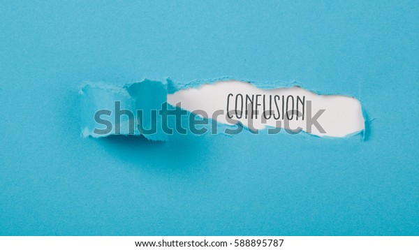 Confusion message on torn blue paper revealing secret behind ripped opening.