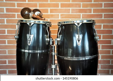Congas and maracas. Congas and maracas in front of a brick wall