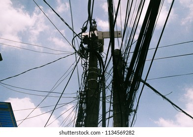 Congested power lines in streets of Vietnam
