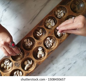 Congklak / Dakon is a traditional Indonesian game. Usually in games, a type of clam shell is used as a congklak seed and if it is absent, it is sometimes also used seeds from plants and small stones.