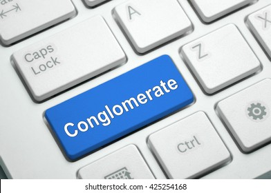 Conglomerate text written on Blue button White Keyboard