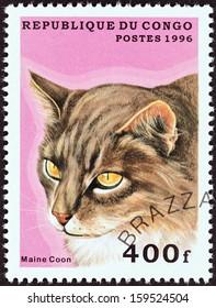 """CONGO REPUBLIC - CIRCA 1996: A stamp printed in Congo from the """"Domestic Cats"""" issue shows a Maine Coon, circa 1996."""