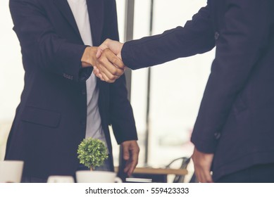 Congratulation to collaboration partner after sign contract. Diversity Businessman shake hands together to introduce in a meeting. Trustworthy student friends meeting. Business Concept.