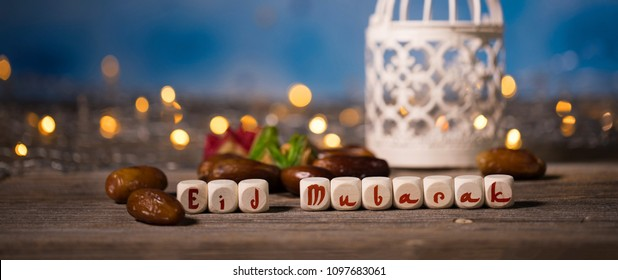 Congratulation EID MUBARAK composed of wooden dices. Closeup