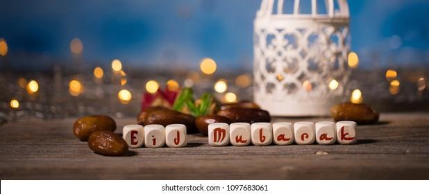 Congratulation EID MUBARAK composed of wooden dices. Closeup
