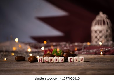 Congratulation HAPPY EID composed of wooden dices. Flag of Qatar in the background