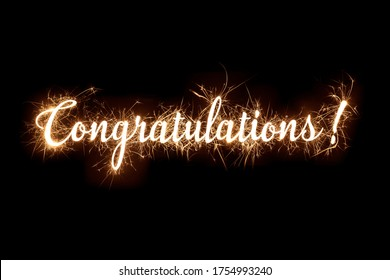 Congratulations banner text in dazzling sparkler effect on dark background