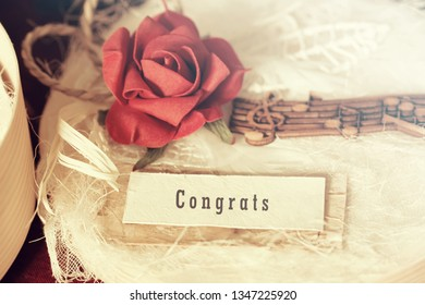 Congratulations Calligraphy on a scrap of paper on a gift box present background