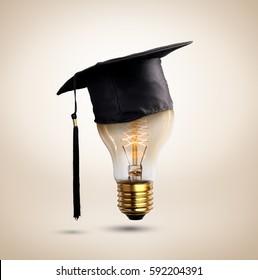 congratulations graduates cap on a lamp bulb, concept of education.