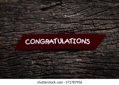 Congratulations on wood background.