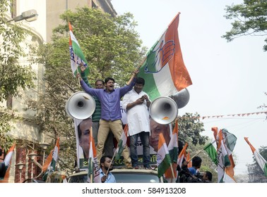 A Congress activist waves flag during a protest rally called by West Bengal Pradesh Congress protest against state government on February 15, 2017 in Calcutta, India.