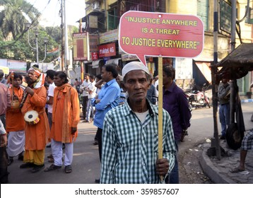 Congress man holds a poster on human rights on the occasion of Human Rights Day rally organized by West Bengal Pradesh Congress on December 10, 2015 in Calcutta, India.