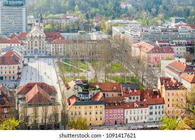 Congress square and buildings on riverbanks of Ljubljanica river in Ljubljana, Slovenia