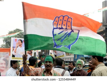 Congress supporter wave Congress flag to celebrate their party good result in the assembly election of Rajasthan, Madhya Pradesh and Chhattisgarh on December 11, 2018 in Calcutta, India.