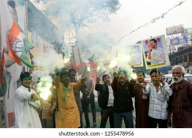 Congress workers burst firecracker to celebrate their party good result in the assembly election of Rajasthan, Madhya Pradesh and Chhattisgarh on December 11, 2018 in Calcutta, India.