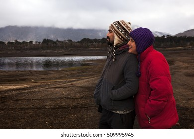 CONGUILLIO-03 MAY, 2015: A couple of Chilean look the horizon and wait the sunset in the Conguillio Park, near Melipeuco, Chile on may 3, 2015